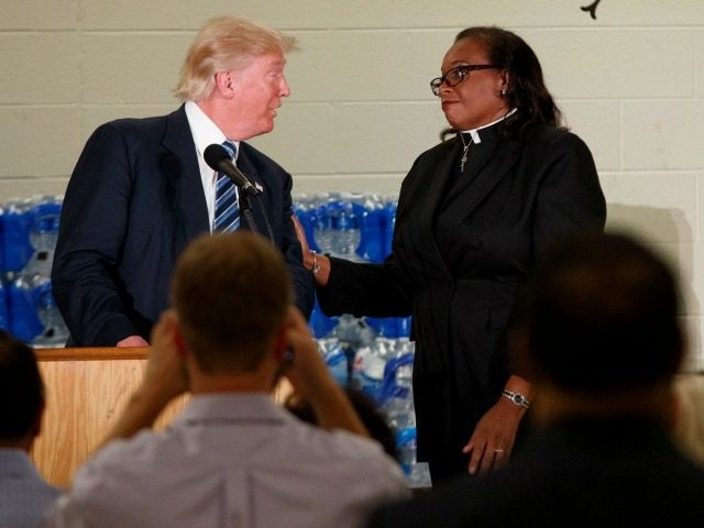 Rev. Faith Green Timmons interrupts Republican presidential candidate Donald Trump as he spoke during a visit to Bethel United Methodist Church, Wednesday, Sept. 14, 2016, in Flint, Mich.