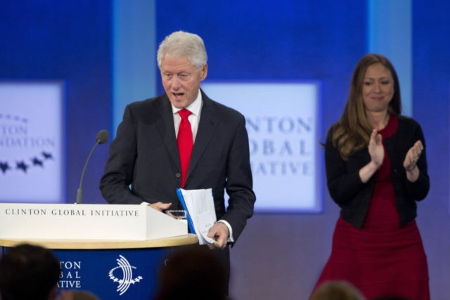 Former U.S. President Bill Clinton moves to the podium after being introduced by his daughter, Chelsea Clinton, on the final day of the Clinton Global Initiative, Wednesday, Sept. 21, 2016, in New York. (AP Photo/Mark Lennihan)