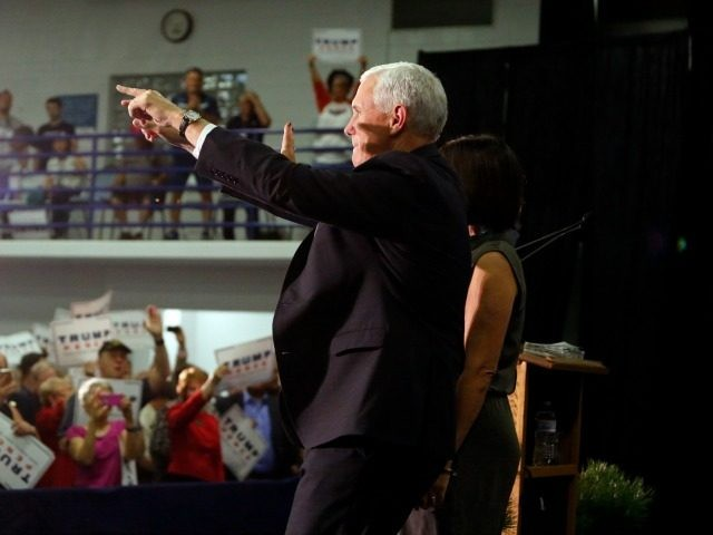 Republican vice presidential candidate Indiana Gov. Mike Pence greets supporters as he arrives at a town hall campaign event at Hillside Community Center, in Colorado Springs, Colo., Thursday, Sept. 22, 2016.