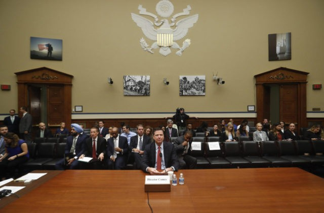 FBI Director James Comey prepares to testify on Capitol Hill in Washington, Wednesday, Sept. 28, 2016, before the House Judiciary Committee hearing on 'Oversight of the Federal Bureau of Investigation.' (AP Photo/Pablo Martinez Monsivais)
