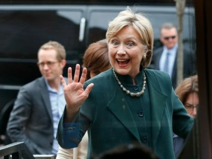 Democratic presidential candidate Hillary Clinton waves entering the Court Street Diner in Athens, Ohio, Tuesday, May 3, 2016. (AP Photo/Paul Sancya)