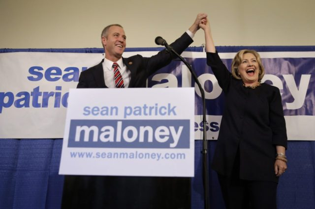 "Rep. Sean Maloney holds hands with former Secretary of State Hillary Rodham Clinton during a ""Women for Maloney"" event in Somers, N.Y., Monday, Oct. 27, 2014. Clinton was there to support Maloney who is running against Nan Hayworth in New York's 18th congressional district. (AP Photo/Seth Wenig)"
