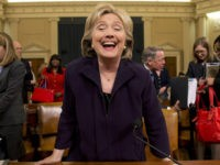 Democratic presidential candidate and former Secretary of State Hillary Rodham Clinton laughs as she stands up at the end of her testimony on Capitol Hill in Washington, Thursday, Oct. 22, 2015, before the House Select Committee on Benghazi. (AP Photo/Jacquelyn Martin)