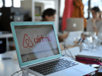 A picture shows the logo of online lodging service Airbnb displayed on a computer screen in the Airbnb offices in Paris on April 21, 2015. AFP PHOTO / MARTIN BUREAU (Photo credit should read MARTIN BUREAU/AFP/Getty Images)