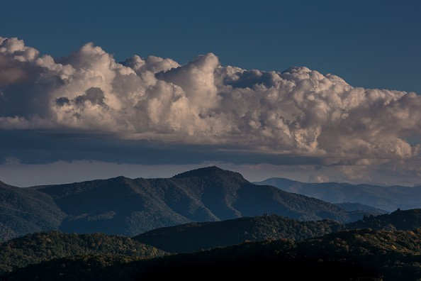 """HOT SPRINGS, NC - OCTOBER 8: The evening sky and distant Tennessee horizon is viewed from Max Patch, a bald mountain that is a favorite camping spot for those hiking the Appalachian Trail, on October 8, 2015 near Hot Springs, North Carolina. Named one of the """"Top 10 Great Places …"""