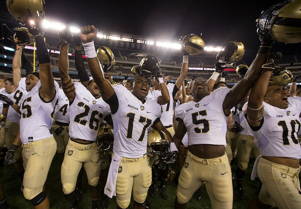PHILADELPHIA, PA - SEPTEMBER 02: Quinten Parker #85, Richard Hanson #26, Ahmad Bradshaw #17, Joe Walker #5, and Gervon Simon #10of the Army Black Knights celebrate after the game against the Temple Owls at Lincoln Financial Field on September 2, 2016 in Philadelphia, Pennsylvania. The Black Knights defeated the Owls …