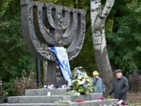 Men react during a visit to the Babi Yar menorah monument in Kiev on September 23, 2016. Ukraine will mark the 75th anniversary next week of the September 1941 mass executions at Babi Yar, in Kiev, of Jews by the Nazis during WWII. Some 34,000 Jews were murdered over two days in September 1941 at Babi Yar, rendering it a symbol of the Holocaust. / AFP / SERGEI SUPINSKY (Photo credit should read SERGEI SUPINSKY/AFP/Getty Images)