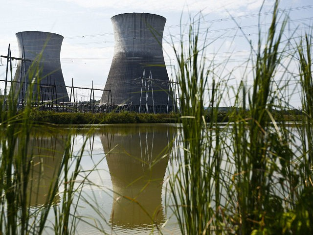 In this Wednesday, Sept. 7, 2016 photo, two cooling towers can be seen in the reflection of a pond outside of the Bellefonte Nuclear Plant, in Hollywood, Ala. The Tennessee Valley Authority has set a minimum bid of $36.4 million for its unfinished Bellefonte Nuclear Plant and the 1,600 surrounding …