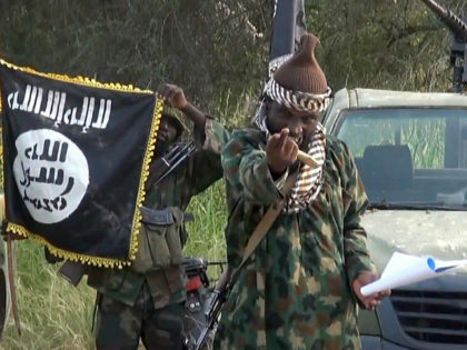 NIGERIA, Kano : A screengrab taken on October 2, 2014 from a video released by the Nigerian Islamist extremist group Boko Haram and obtained by AFP shows the leader of the Nigerian Islamist extremist group Boko Haram, Abubakar Shekau. Shekau dismissed Nigerian military claims of his death in a new …