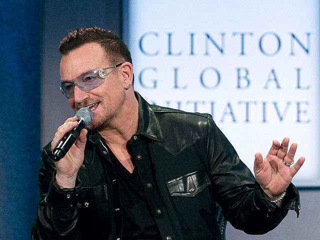 Rockers Bono and Bon Jovi help Bill Clinton bid farewell to Clinton Global Initiative.