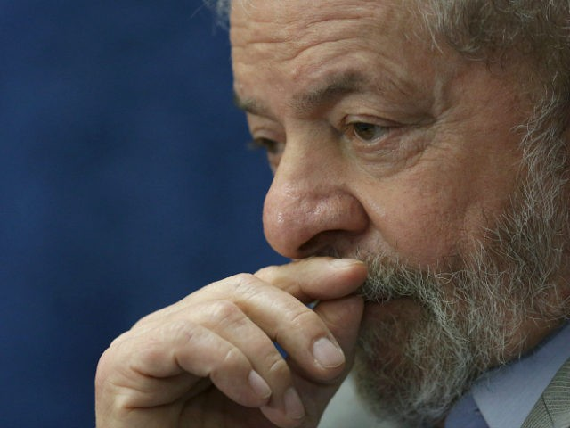 Brazil's former President Luiz Inacio Lula da Silva attends the impeachment trial of Brazil's suspended President Dilma Rousseff, in Brasilia, Brazil, Monday, Aug. 29, 2016. Fighting to save her job, Rousseff told senators on Monday that the allegations against her have no merit. Rousseff's address comes on the fourth day of the trial. (AP Photo/Eraldo Peres)