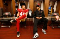 SANTA CLARA, CA - JANUARY 3: Bruce Miller #49 and Colin Kaepernick #7 of the San Francisco 49ers relax in the locker room prior to the game against the St. Louis Rams at Levi Stadium on January 3, 2016 in Santa Clara, California. The 49ers defeated the Rams 19-16. (Photo by Michael Zagaris/San Francisco 49ers/Getty Images)