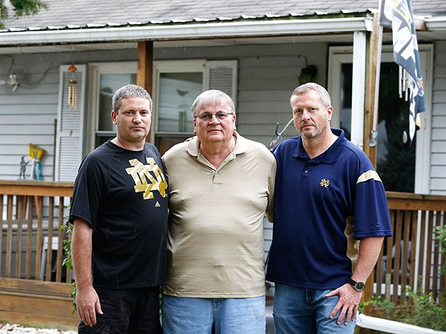 Bruce Reynolds (center) with sons Robert (left) and Bruce Jr. (Chris Bergin/Reuters)