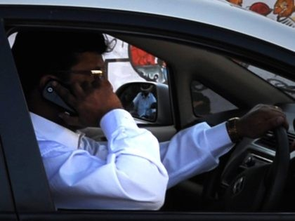 Cell phone driver (Dibyangshu Sarkar / AFP / Getty)