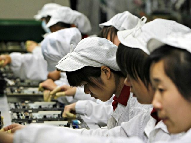 Staffs works on the production line at the Foxconn complex in the southern Chinese city of Shenzhen, Southern city in China, Wednesday, May 26, 2010. The head of the giant electronics company whose main facility in China has been battered by a string of worker suicides opened the plant's gates …