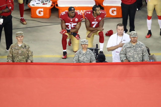 SANTA CLARA, CA - SEPTEMBER 12: Colin Kaepernick #7 and Eric Reid #35 of the San Francisco 49ers kneel in protest during the national anthem prior to playing the Los Angeles Rams in their NFL game at Levi's Stadium on September 12, 2016 in Santa Clara, California. (Photo by Ezra …