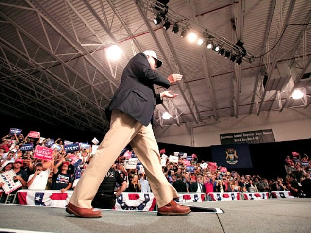DIMONDALE, MI - AUGUST 19: Republican presidential nominee Donald Trump makes his way to the podium to speak at a campaign rally August 19, 2016 in Dimondale, Michigan. Earlier in the day, Trump toured flood-ravaged Louisiana. (Photo by Bill Pugliano/Getty Images) *** TRUMP ***