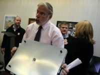 Assemblyman Dov Hikind holds a hot plate to show the dangers of leaving it unintended at a news conference following the fire that claimed the lives of seven children last Saturday in the Midwood neighborhood in Brooklyn on March 24, 2015 in New York City. Investigators say a hot plate …
