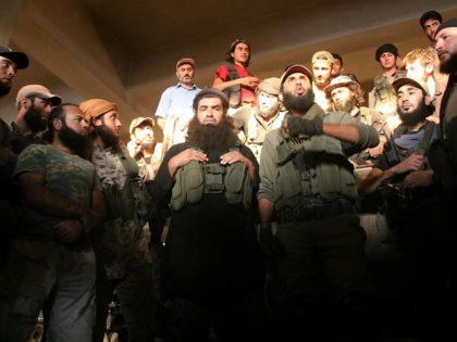 Fighters from the former Al-Nusra Front -- renamed Fateh al-Sham Front after breaking from Al-Qaeda -- listen to a speech at an armament school after they recaptured two military academies and a third military position south of Aleppo on August 6, 2016, the Syrian Observatory for Human Rights said. A …