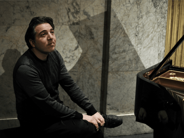 A photo taken on February 9, 2010 shows Turkish pianist and composer Fazil Say posing at the Theatre des Champs-Elysees in Paris. Fazil Say,charged with attacks on religious values for a series of provocative tweets about Islam, will go on trial from October 17, 2012. Under Turkish law, anyone convicted …