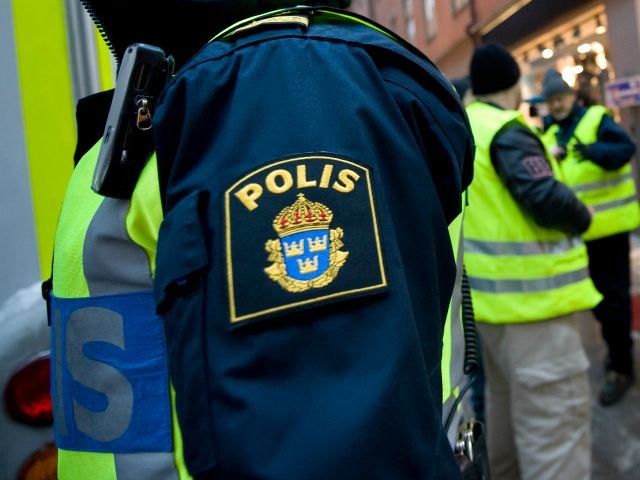 Swedish police volunteers patrol on December 13, 2010 at the corner of Bryggaregatan and Drottninggatan street in central Stockholm, where an apparent car bomb and a separate blast targeted Christmas shoppers two days ago. Sweden's chief prosecutor said today investigators were almost certain the author of the failed suicide attack …