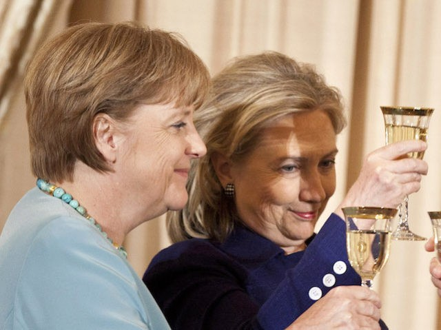 WASHINGTON - JUNE 7: (L-R) German Chancellor Angela Merkel, Secretary of State Hillary Rodham Clinton and Vice President Joseph R. Biden toast each other during a luncheon at the US State Department June 7, 2011 in Washington, DC. Secretary of State Hillary Rodham Clinton and Vice President Joseph R. Biden …