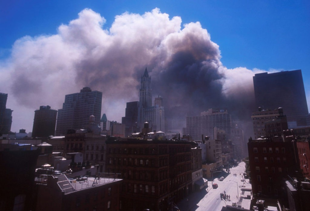 394273 10: Smoke billows from the World Trade Center's twin towers after they were struck by commerical airliners in a suspected terrorist attack September 11, 2001 in New York City. (Photo by Ezra Shaw/Getty Images)