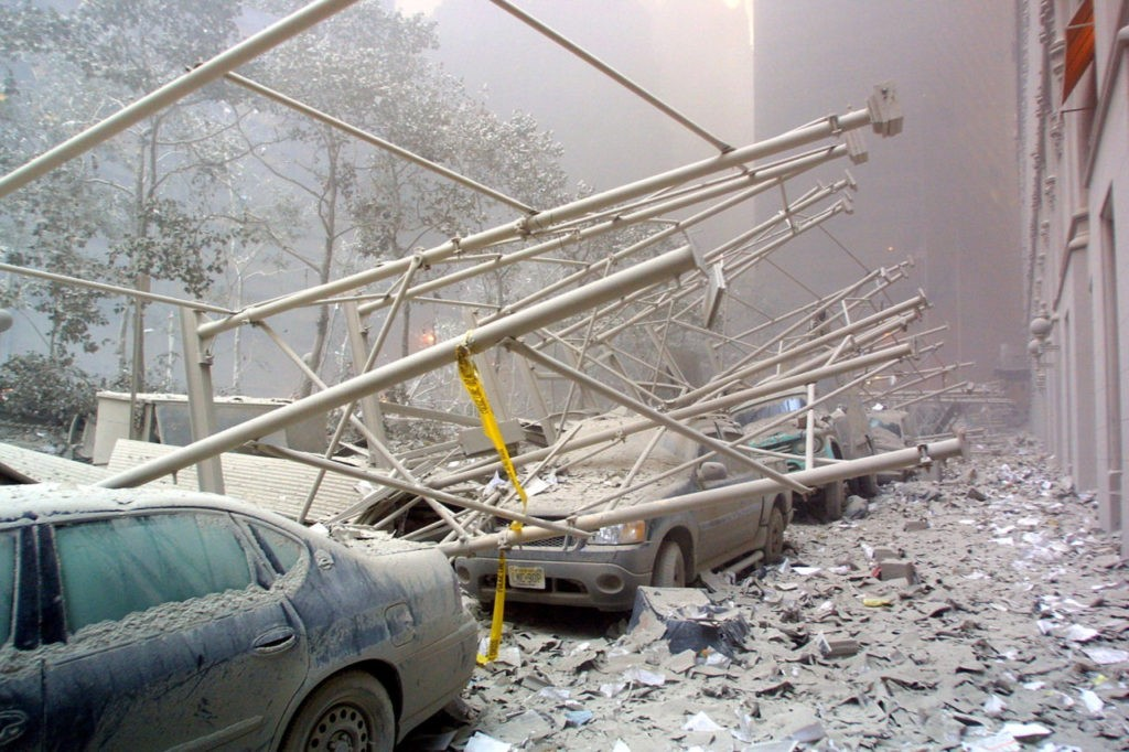 Cars are covered in rubble after the collapse of one of the World Trade Center Towers 11 September, 2001 in New York. US President George W. Bush is to call a meeting of his top national security aides to address terrorist attacks that levelled the World Trade Center and left part of the Pentagon in ruins. AFP PHOTO Doug KANTER (Photo credit should read DOUG KANTER/AFP/Getty Images)