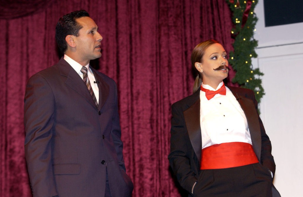 Actress Leah Remini (R) performs on stage at the Church of Scientology's fundraiser, 'Christmas Stories X' to benefit the Hollywood Police Activities League on December 7, 2002 at the Scientology Celebrity Centre in Hollywood, California. (Robert Mora/Getty Images)