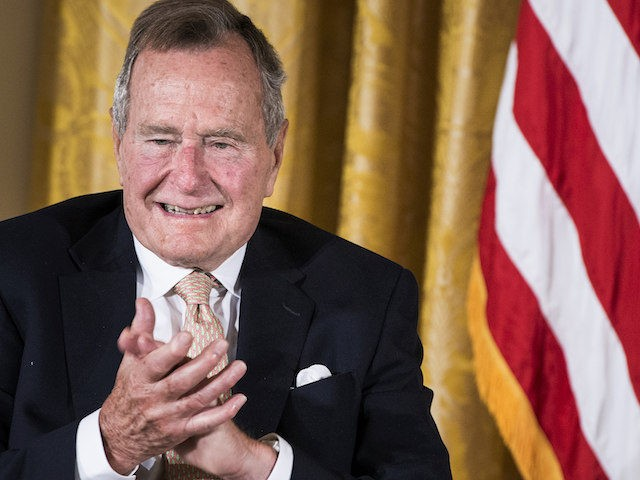 Former US President George H. W. Bush applauds during an event in the East Room of the White House July 15, 2013 in Washington, DC. US President Barack Obama hosted former US President George H. W. Bush and Barbara Bush to honor the 5000th Daily Point of Light Award which …