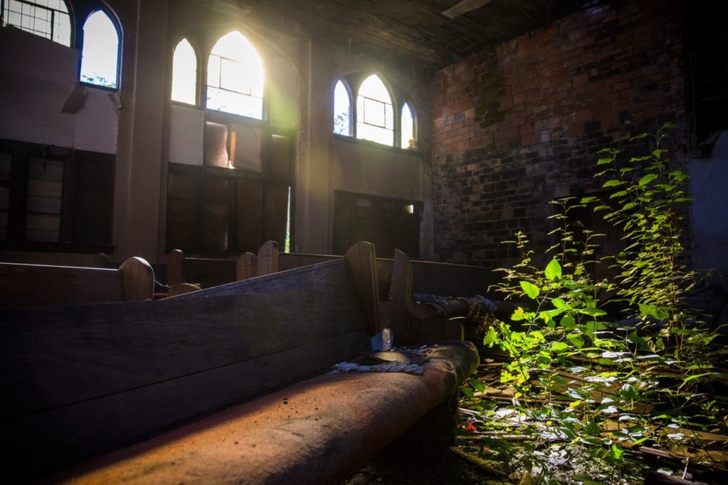 DETROIT, MI - SEPTEMBER 05: The interior of an abandoned church is seen on September 5, 2013 in Detroit, Michigan. Detroit is struggling with over 78,000 abandoned homes across 140 square miles and 16% unemployment; in July, the city declared bankruptcy. (Photo by Andrew Burton/Getty Images)