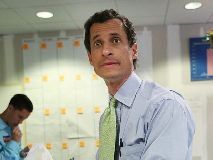 NEW YORK, NY - SEPTEMBER 09: Democratic mayoral candidate Anthony Weiner prepares to eat a sandwich during a break from working the phone bank at campaign headquarters on September 9, 2013 in New York City. The city's primary mayoral election is September 10 with the general election scheduled for November 5. (Photo by Mario Tama/Getty Images)