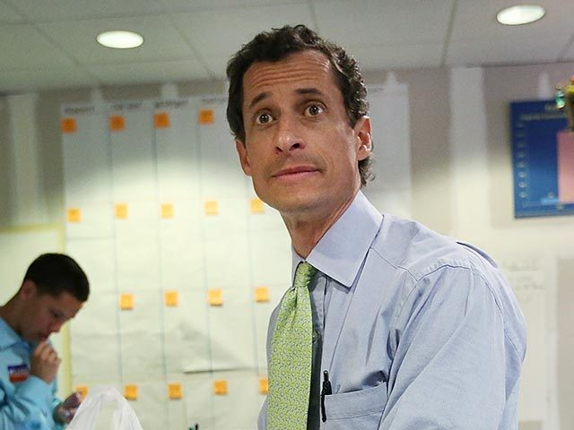 NEW YORK, NY - SEPTEMBER 09: Democratic mayoral candidate Anthony Weiner prepares to eat a sandwich during a break from working the phone bank at campaign headquarters on September 9, 2013 in New York City. The city's primary mayoral election is September 10 with the general election scheduled for November …