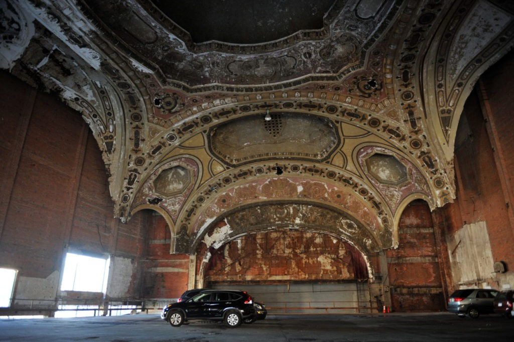 Detroit's once glorious and now decrepit Michigan Theater, saved from the wrecking ball by being transformed into a car park, is seen on on October 2, 2013 in Detroit Michigan. The city of Detroit's spectacular bankruptcy -- the largest in US history when it was filed in July and a complex legal process expected to take years to complete -- has masked a long-sought revival which is gathering momentum. But outside a handful of healthy and transitioning neighborhoods lies an urban wasteland housing 78,000 abandoned buildings. AFP PHOTO / Mira OBERMAN (Photo credit should read MIRA OBERMAN/AFP/Getty Images)