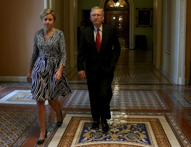 WASHINGTON, DC - SEPTEMBER 30: Senate Majority Leader Mitch McConnell (R-KY) walks with an aide as he leaves the Senate Chamber after a vote to avert a government shutdown, on Capitol Hill September 30, 2015 in Washington, DC. The Senate voted in favor of a funding bill that would avert …