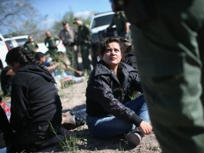 Border Patrol questions an undocumented immigrant from El Salvador after she illegally crossed the U.S.-Mexico border and was caught with a group of fellow immigrants on December 7, 2015 near Rio Grande City, Texas.