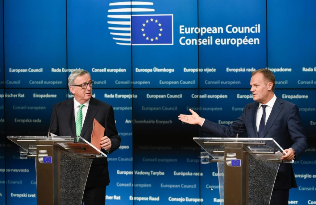 European Commission President Jean-Claude Juncker (L) and President of Council Donald Tusk give a joint press during an European Summit at the EU Headquarters in Brussels on February 20, 2016. The deal, sealed after hours of haggling at a marathon summit, paves the way for a referendum on whether Britain will stay in the EU. The European Union's two top figures, Donald Tusk and Jean-Claude Juncker, presented its 28 leaders with draft proposals at a long-delayed dinner after hours of painstaking face-to-face talks on an issue that threatened place in the union. / AFP / JOHN THYS (Photo credit should read JOHN THYS/AFP/Getty Images)