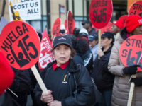 Latino and African-American workers campaign for a $15 minimum wage.