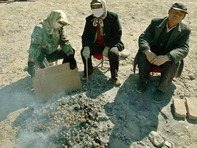 Stablemen warm theirselves by burning horse excrement while waiting for customers at the famed tourist attraction Jiayuguan Pass, in China's northwestern province of Gansu, 13 October 2005. A yawning gap between rich and poor in China is seriously threatening social stability, the United Nations said in a report on December …