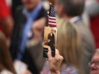 A delegate holds up a copy of the constitution at the Republican National Convention at the Quicken Loans Arena in Cleveland, Ohio on July 20, 2016.