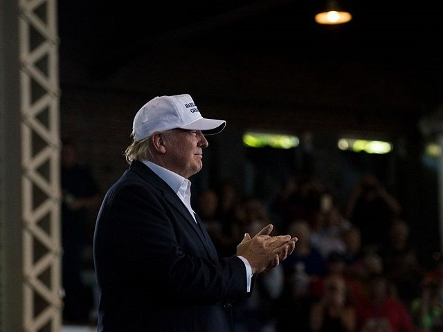 Republican presidential nominee Donald Trump walks on stage to speak at the 2nd annual Joni Ernst Roast and Ride event on August 27, 2016 in Des Moines, Iowa. Trump joined a number of Iowa Republicans who also spoke. (Photo by Stephen Maturen/Getty Images)