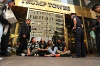 """NEW YORK, NY - AUGUST 31: Protesters block the entrance to Trump Tower in Manhattan before being arrested on August 31, 2016 in New York City. The action, called """"hecho por inmigrantes,"""" or """"built by immigrants,"""" was intended to draw attention to Republican Presidential nominee Donald Trump's immigration policies on …"""