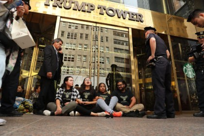 "NEW YORK, NY - AUGUST 31: Protesters block the entrance to Trump Tower in Manhattan before being arrested on August 31, 2016 in New York City. The action, called ""hecho por inmigrantes,"" or ""built by immigrants,"" was intended to draw attention to Republican Presidential nominee Donald Trump's immigration policies on …"