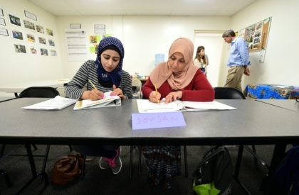 Syrian refugees take notes during their Vocational ESL class at the International Rescue Committee center in San Diego on August 31, 2016. Seated from left to right are: Rawa Hawara and Sousan Alziat. The United States has taken in10,000 Syrian refugees in 2016 as part of a resettlement program that …