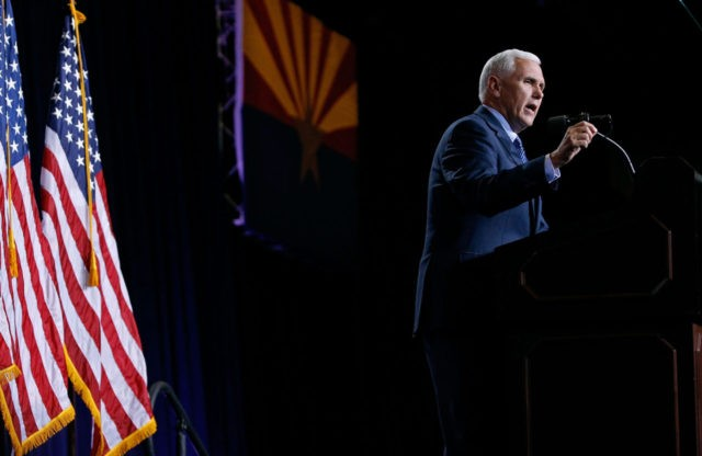 PHOENIX, AZ - AUGUST 31: Republican vice presidential candidate Mike Pence speaks to a crowd of supporters at a campaign rally for presidential candidate Donald Trump on August 31, 2016 in Phoenix, Arizona. (Photo by Ralph Freso/Getty Images)