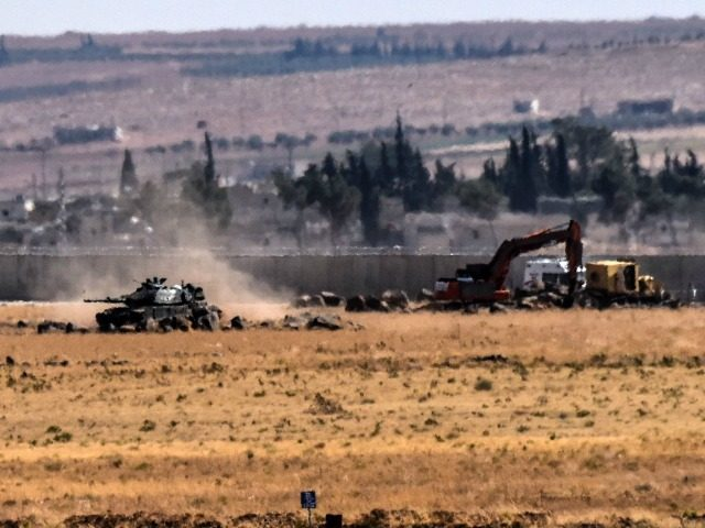 This picture taken on September 4, 2016 at Elbeyli, in the southern region of Kilis, shows Turkish tank coming from Syria during clashes betweenTurkish army and ISIS militants. Ankara stepped up its fight against militants in Turkey and northern Syria with air strikes on Kurdish rebel positions in the restive …