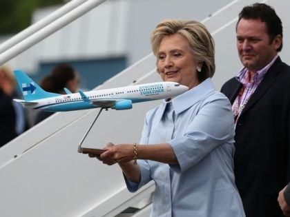 Democratic presidential nominee former Secretary of State Hillary Clinton looks at a scale model of her new campaign plane at Westchester County Airport on September 5, 2016 in White Plains, New York.