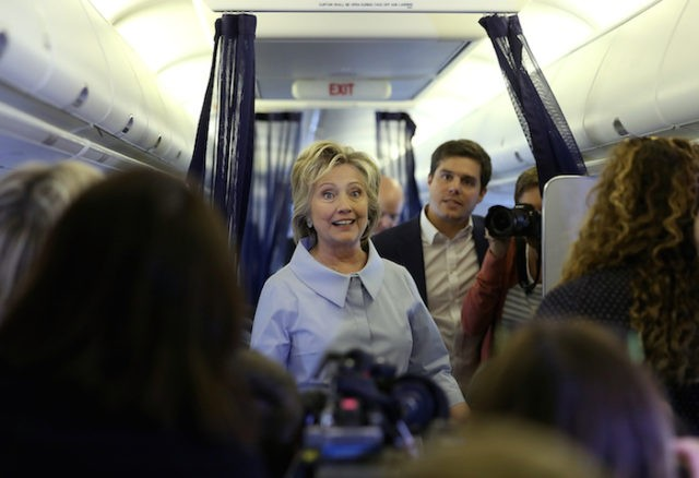 WHITE PLAINS, NY - SEPTEMBER 05: Democratic presidential nominee former Secretary of State Hillary Clinton chats with reporters aboard her new campaign plane at Westchester County Airport on September 5, 2016 in White Plains, New York. Clinton is kicking off a Labor Day campaign swing to Ohio and Iowa on …
