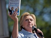 "Democratic presidential nominee Hillary Clinton talks about the book ""Stronger Together"" during a Labor Day rally September 5, 2016 in Cleveland, Ohio. / AFP / Brendan Smialowski (Photo credit should read BRENDAN SMIALOWSKI/AFP/Getty Images)"