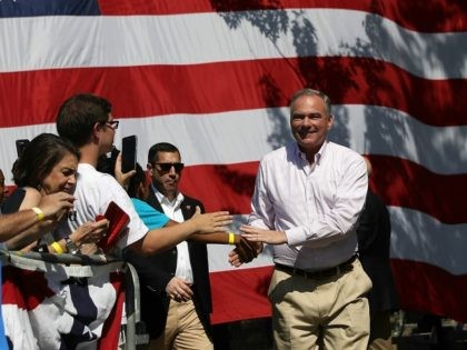 Democratic vice presidential nominee Tim Kaine greets supporters during a campaign rally with Democratic presidential nominee former Secretary of State Hillary Clinton at Luke Easter Park on September 5, 2016 in Cleveland, Ohio.